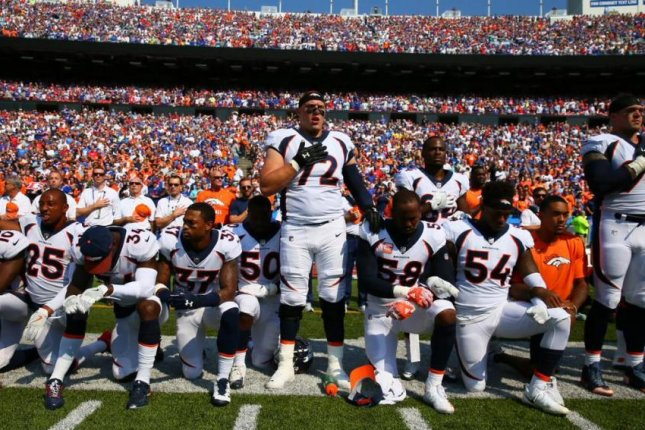 Denver Broncos cornerback Chris Harris Jr. and tight end Virgil Green raised their fists. Von Miller (58), Aqib Talib and Demaryius Thomas were among the players who kneeled, as did more than half of Denver's players and coaches. Photo courtesy of SInow/Twitter