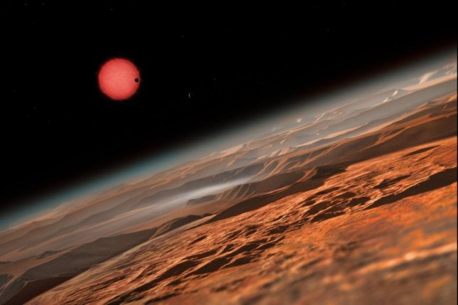 An artistic rendering shows what the ultracool dwarf star might look like from the surface of one of the three newly identified habitable exoplanets. Photo by ESO/M. Kornmesser