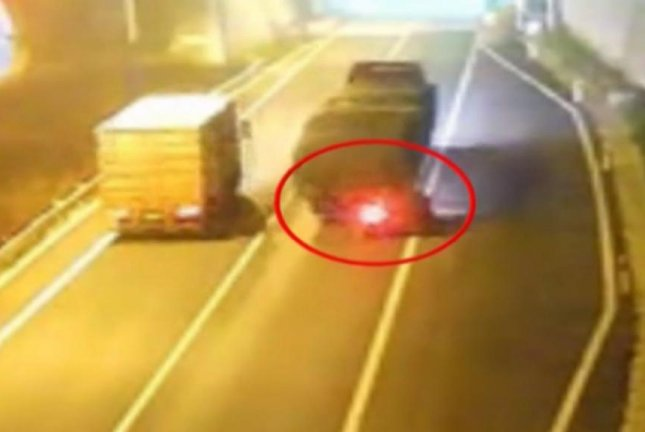 A car is dragged behind a semi truck after rear-ending it in heavy smog. Screenshot: Newsflare