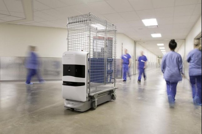 The New Stanford Hospital makes use of 28 TUG robots like the one pictured here to make deliveries.  Photo courtesy of Stanford Hospital/Kevin Meynell Photography