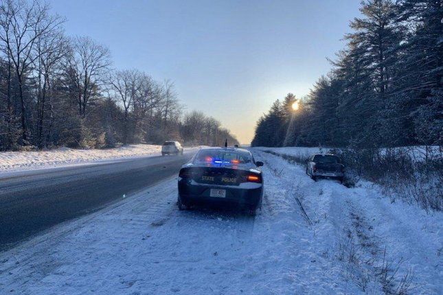 New Hampshire Sgt. Sampson responds to a motorist on Sunday morning who was found to be driving too fast for the existing road conditions on Interstate 89. Photo courtesy NHSP/Twitter