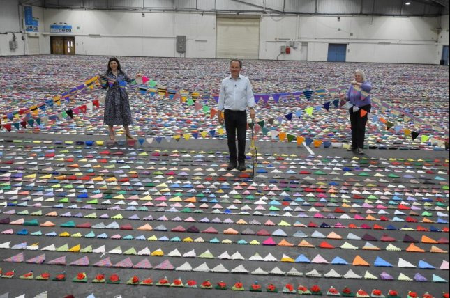 The Devon County Show in Britain broke a Guinness World Record for the world's largest knitted bunting when 79,001 knitted flags submitted by knitters around the world were strung together for a total length of 8.9 miles. Photo courtesy of the Devon County Show