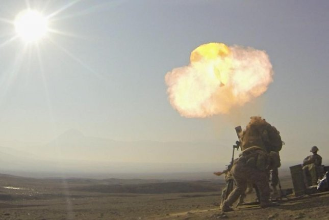 Orbital ATK's M1061 60mm mortar cartridge has received full materiel release approval by the U.S. Army's Joint Munitions Command, the company said Thursday. Soldiers are shown here hanging a mortar round in Afghanistan in 2013. U.S. Army photo