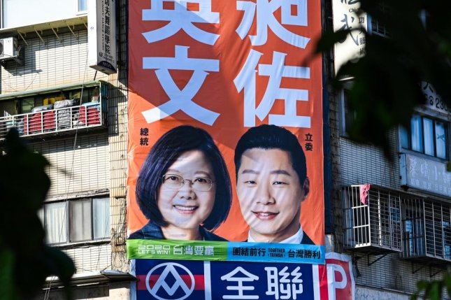 A campaign poster shows President Tsai Ing-wen and legislator Freddy Lim in Taipei, Taiwan, ahead of general elections Saturday. Photo by Thomas Maresca/UPI
