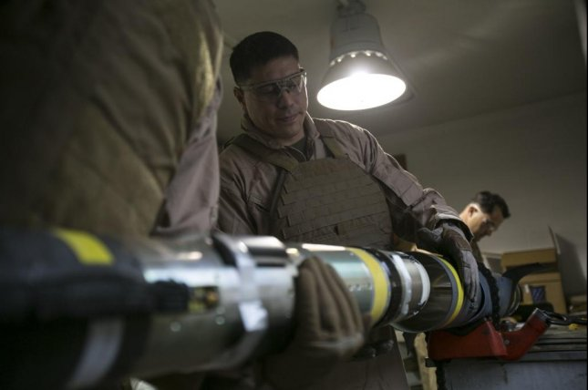 Master Sgt. Jerry Slattum, an Explosive Ordnance Disposal technician with EOD Company, carefully removes a Griffin missile from its casing at Camp Lejeune, N.C., Dec. 1, 2015. The Griffin is a lightweight mini missile developed by Raytheon that can be launched from air or ground. Raytheon has been contracted to conduct further research into next-generation miniaturized missiles. U.S. Marine Corps photo by Lance Cpl. Luke Hoogendam
