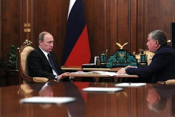 Russian President Vladimir Putin (L) told director of state oil company Rosneft the Kremlin is keeping a close eye on crude oil market conditions. Photo courtesy of the Office of the Russian President