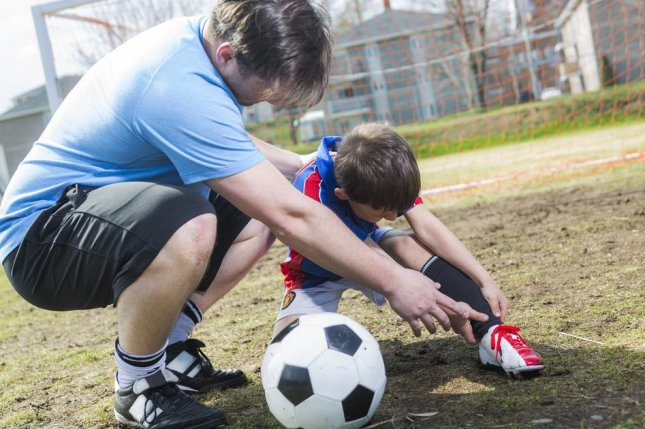 Stretching and muscle strengthening can decrease the risk of ankle injuries from soccer by about 40 percent, say researchers in a new study. Photo by Lopolo/Shutterstock