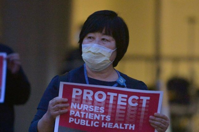 Nurses in New York filed suit against two hospitals and the state health department alleging they are forced to work in dangerous conditions while treating patients with COVID-19. File photo by Jim Ruymen/UPI