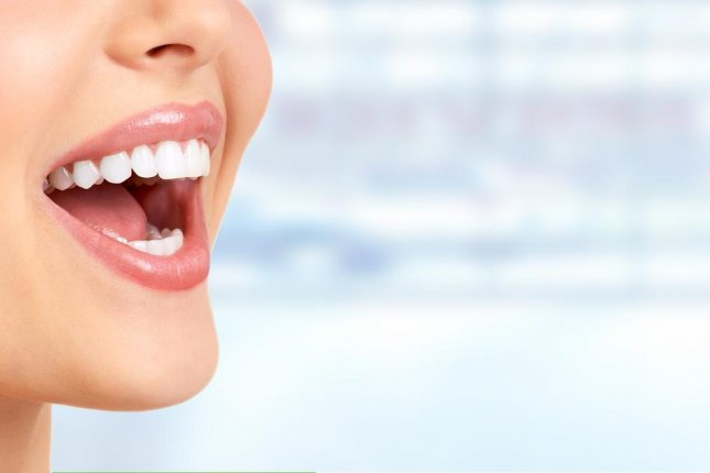 The combination of nanoparticles and hydrogen peroxide cleared biofilms on teeth where bacteria hide, allowing them to cause tooth decay, according researchers at the University of Pennsylvania. Photo by kurhan/Shutterstock