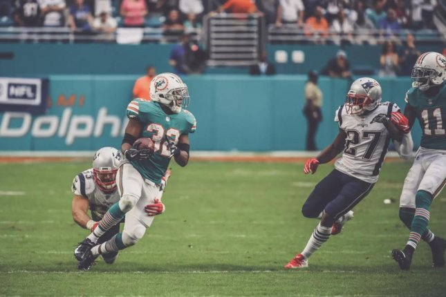 Kenyan Drake scored a 52-yard touchdown as time expired to help the Miami Dolphins beat the New England Patriots on Sunday in Miami. Photo courtesy of the Miami Dolphins