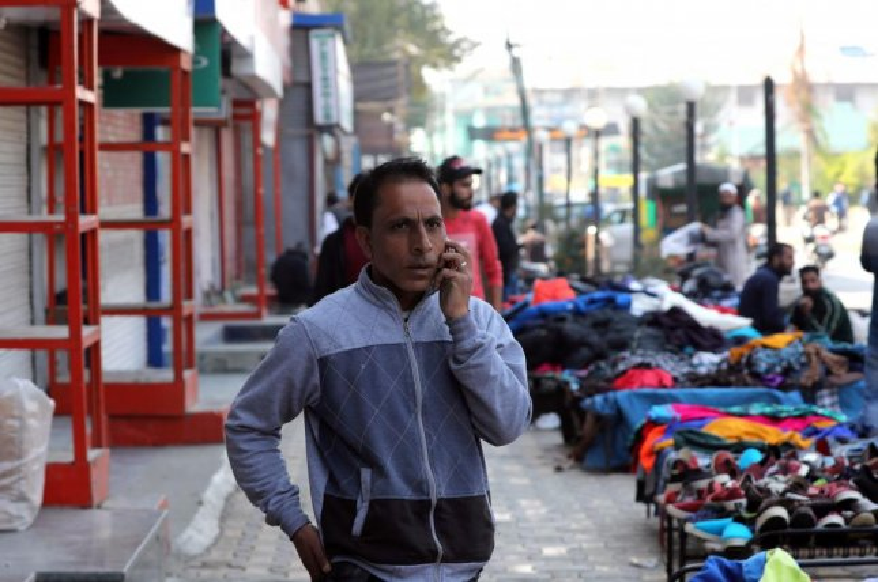 A Kashmir man calls over his mobile phone in Srinagar, the summer capital of Indian Kashmir Monday. Photo by Farooq Khan/EPA-EFE