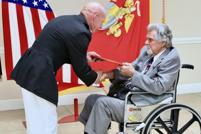 U.S. Marine Corps veteran Salvatore Naimo, R, was awarded the Silver Star on Friday for Korean War heroism in 1951. Photo by Gunnery Sgt. Eric Alabiso/U.S. Marine Corps