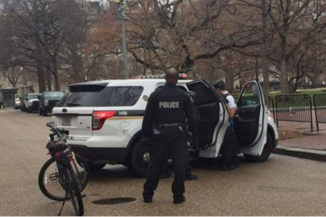 Police assist Secret Service after people were ordered to shelter-in-place after discovering a man who said he had a bomb near the White House. Photo courtesy Secret Service/Twitter