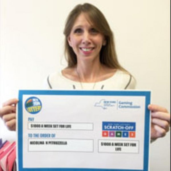 A New York state woman said waiting in line to check her lottery tickets at a scanner led her to buy a scratch-off that earned her $1,000 a week for life. Photo courtesy of the New York Lottery