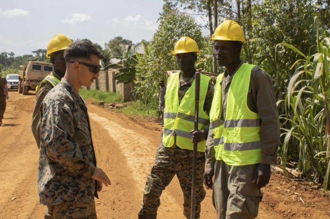 U.S. Marines and members of the Uganda People's Defence Force restructure a local village road in the vicinity of Camp Jinja, Uganda on Monday. This week the Pentagon announced that U.S. Africa Command is shifting its strategy, though whether the U.S. will retain a presence on the continent is unclear. Photo by Grace Jenkins/U.S. Marine Corps