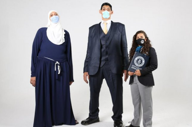 Siblings Huda andMohamed Shehata collectively hold five Guinness World Records after their hands, feet and arm spans were measured by a Guinness adjudicator. Photo courtesy of Guinness World Records