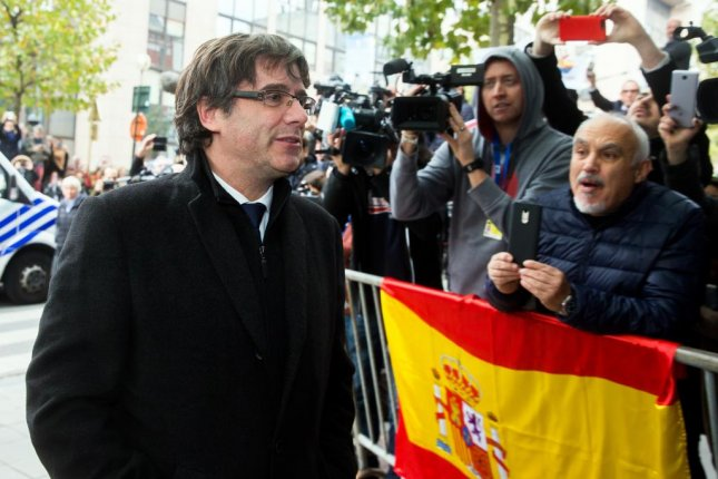 Former Catalonia President Carles Puigdemont arrives at a press club in Brussels, Belgium, on Tuesday -- ousted from his region over a failed bid for independence. Photo by Stephanie Lecoco/EPA