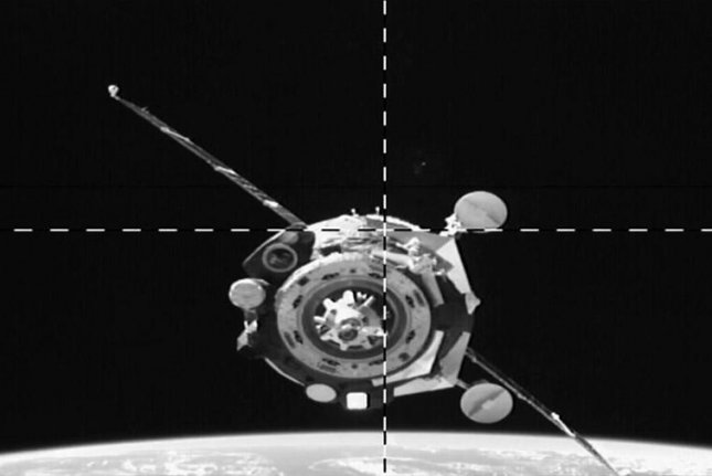The camera on the rear port of the space station's Zvezda service module captured the Soyuz MS-15 spacecraft as it approached for docking. Photo by NASA TV