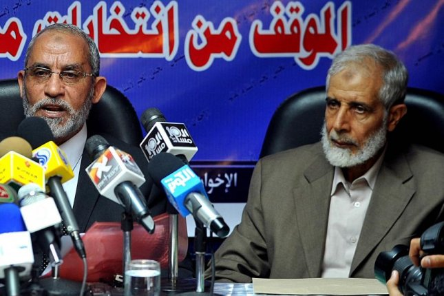 Mahmoud Ezzat (R) is seen during a news conference in Cairo, Egypt, on October 9, 2010. He was arrested by authorities in Cairo on Friday. File Photo by Mohamed Omar/EPA