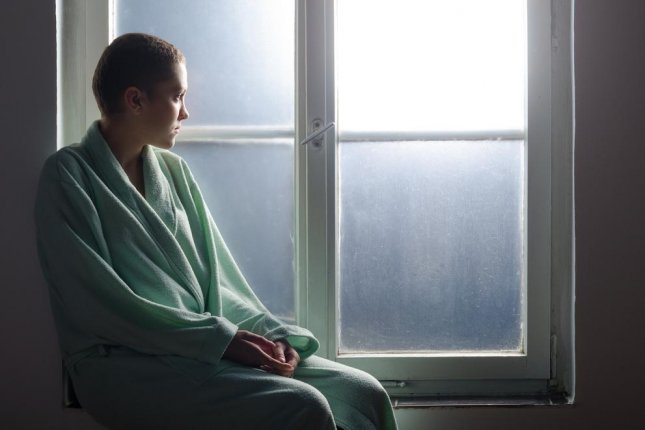 While the effect of depression on cancer isn't clear, researchers said all patients should seek treatment for prolonged and elevated levels of depression. Photo by prudkov/Shutterstock