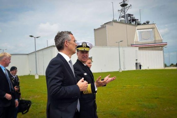 NATO Secretary General Jens Stoltenberg, C., visited the Deveselu air base in Romania at the start of construction of its Aegis Ashore defense system in 2016. NATO announced the completion of construction on Friday. Photo courtesy of NATO