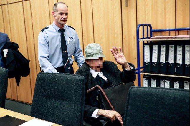 Defendant Johann Rehbogen arrives for a session of the trial against him at the Regional Court in Muenster, Germany Tuesday. His face was pixelated in photos on court order. Pool photo by Friedemann Vogel/EPA