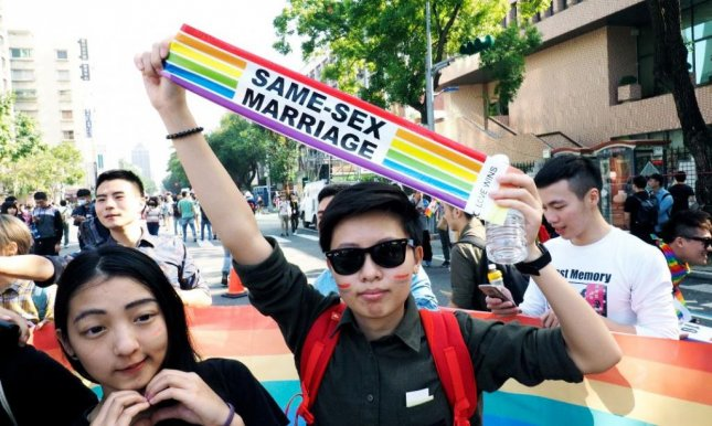 Thousands rally in Taiwan to protest, support same-sex