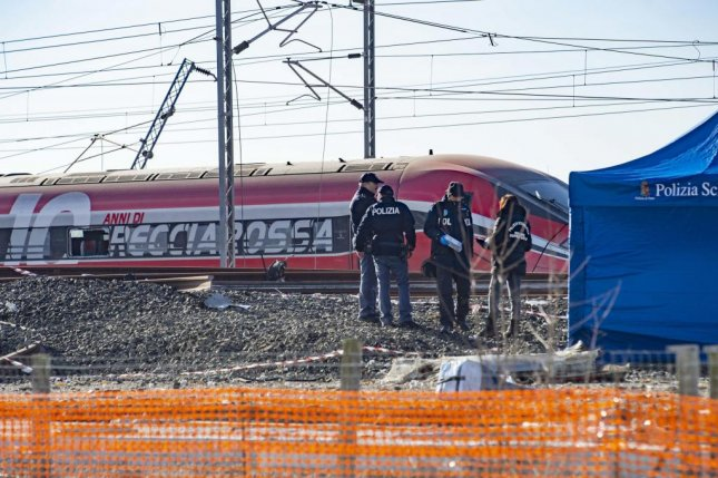Italian police gather at the site of a high-speed trail derailment Thursday on the Milan-Bologna line, near Lodi in northern Italy. Two people were killed in the crash. Photo by Andrea Fasani/EPA-EFE