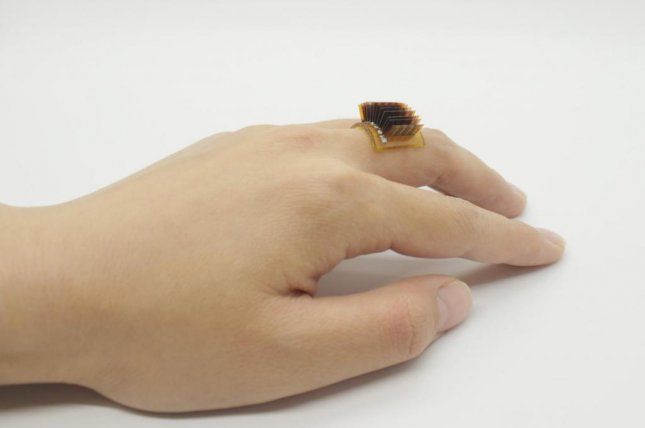 Scientists at the University of Colorado have developed a new wearable device that captures the body's thermal energy and converts it into electricity. Photo by Xiao Lab