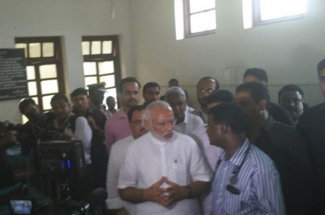Indian Prime Minister Narendra Modi visited the scene of the tragic temple explosion and subsequent blaze that has killed at least 106 and injured over 300 others in southern India. Photo from PMO India/Twitter
