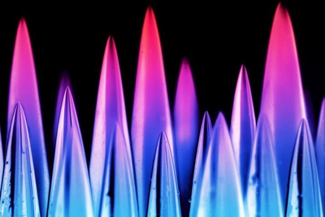 A false-color photo shows a sugar-based spikes resembling a stone forest. Photo by NYU's Applied Mathematics Lab
