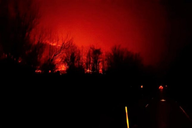 The glow from a wildfire can be seen in the Great Smoky Mountains National Park in Tennessee, where flames have destroyed dozens of structures. Authorities said the fires, which caused the death of at least three people, are the worst in Tennessee in more than a century. Photo courtesy Great Smoky Mountains National Park