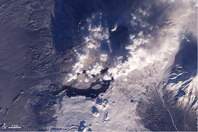 A natural color photograph of the Tolbachik volcano in Russia. Credit: NASA