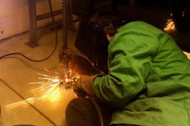 A high school student in Indiana's Perry Central Community Schools welds a piece for a nearby manufacturing company. Photo by Jessie Higgins/UPI