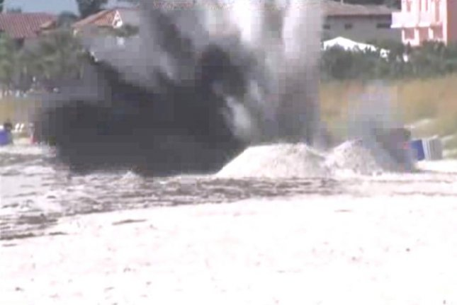 A World War II-era bomb washed up in Pass-a-Grille, Fla., and was detonated by authorities. WFTV video screenshot