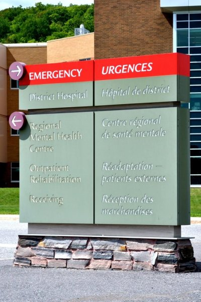 Quebec's French language office has demanded the removal of bilingual signs from hospitals whose English-speaking populations are less than 50 percent. Photo by Lester Balaiadia/Shutterstock