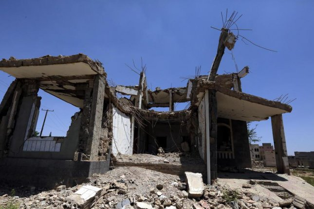 A destroyed house is seen in Sanaa, Yemen, on Thursday. Officials said Friday the Saudi-led coalition launched a series of air raids near the port city of Hudaydah.  Photo by Yahya Arhab/EPA-EFE