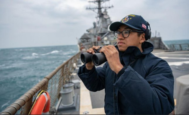 U.S. Navy Seaman Xi Chan stands lookout aboard the USS Barry as it transits the Taiwan Strait last April, one of several the Department of Defense highlighted Wednesday in an annual report on its Freedom of Navigation operations. Photo by Ensign Samuel Hardgrove/U.S. Navy