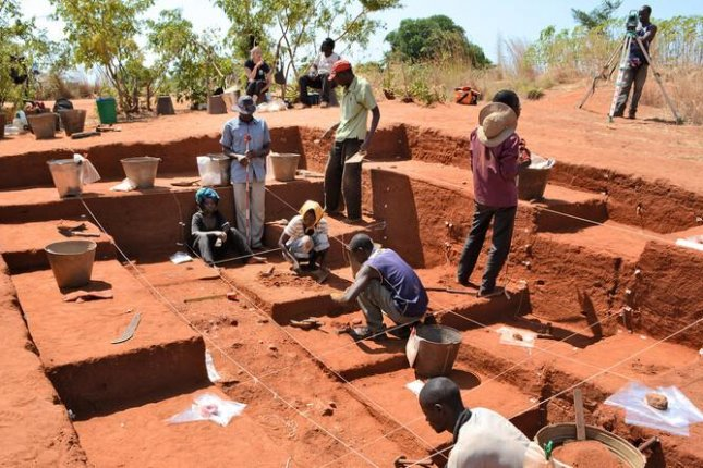 Excavations near Lake Malawi in eastern Africa yielded dense clusters of stone artifacts dating as far back as 92,000 years ago, suggesting humans used fire to control their environment at the time. Photo by Yale University