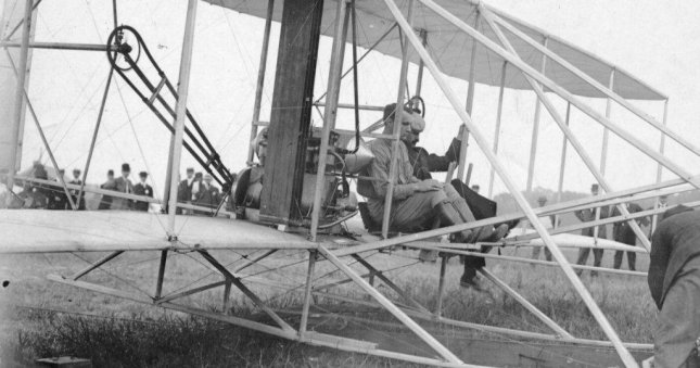 Lt. Thomas Selfridge in the cockpit of the the Wright Flyer with Orville Wright just before take off. Photo courtesy of Wright-Brothers.org