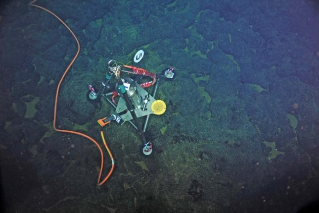 The new sensor technology can measure the rise and fall of the sea floor along the sides of the volcanic seamounts. There are three devices currently installed on the caldera of Axial Volcano. Photo by NSF-OOI/UW/CSSF