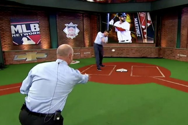 Sean Casey winds up for a swing against Billy Ripken during a segment Monday on MLB Network. Photo courtesy of MLB Network/Facebook.