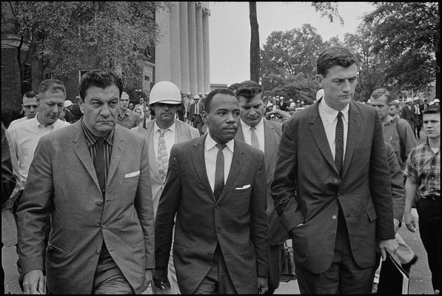 James Meredith (C) is escorted to class at the University of Mississippi in 1962. A year later, Meredith became the first African American to graduate from the Oxford, Miss., campus. Photo courtesy of Marion S. Trikosko/U.S. News & World Report/Wikimedia Commons