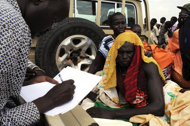 An injured woman is evaluated prior to evacuation in the aftermath of bombings in South Sudan on April 16, 2012. UN Photo/Isaac Billy
