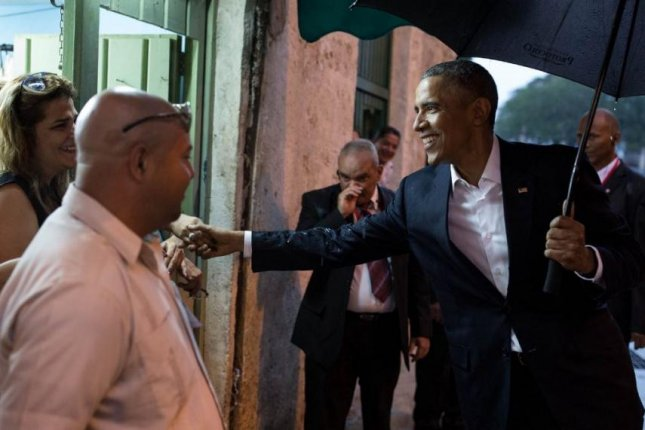 President Barack Obama shakes hands with Cuban citizens in Havana on Sunday. Obama's arrival Sunday marked the first visit to the island nation by any sitting American president since Calvin Coolidge visited in January 1928. Photo courtesy The White House/Ben Rhodes