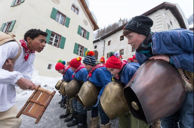 Children walk with cowbells through the streets of the village of Ardez in the valley of Engadin in eastern Switzerland, during the Chalandamarz winter festival. Cowbells are a longstanding tradition in Switzerland, but don't tell that to animal rights activist Nancy Holten, whose opposition to them cost her a chance to become a Swiss citizen. Photo by Arno Balzarini/European Pressphoto Agency