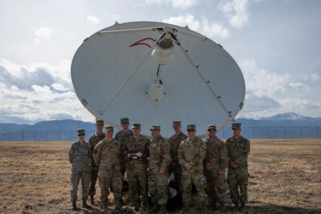 Members of the 4th Space Control Squadron at Peterson AFB, Colo., pose with their newest acquisition, the Counter Communication System Block 10.2, meant to disrupt transmissions from enemy satellites. Photo courtesy of A1C Andrew Bertain, U.S. Air Force