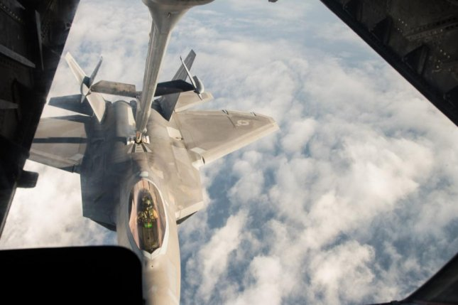 United States Air Force F-22 Raptor receives fuel from a KC-10 Extender over Syria, during a mission in support of Operation Inherent Resolve on Nov. 22, 2017. The F-22 is a component of the Global Strike Task Force. Photo by Staff Sgt. Colton Elliott/U.S. Air National Guard