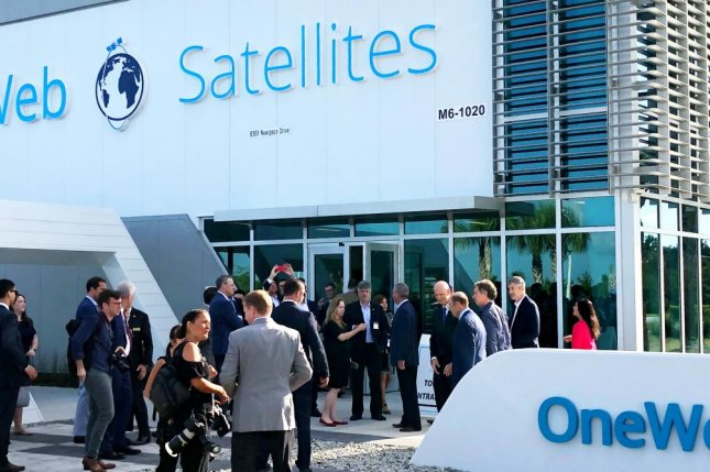 A group of VIPs gathers in front of the OneWeb satellite plant in Merritt Island, Fla., on Monday for the ribbon-cutting. Photo by Paul Brinkmann/UPI