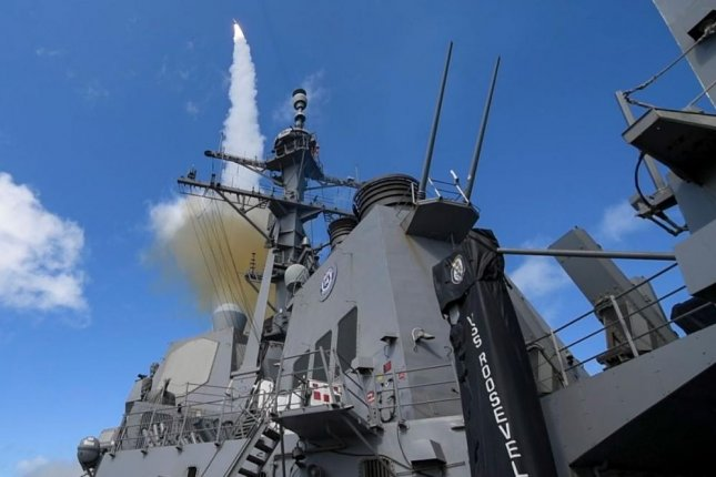 An SM-2 guided missile is fired from the USS Roosevelt. Raytheon Missile Systems was awarded a $13.2 million contract for missile engineering and technical services on Tuesday by the Defense Department. Photo by MCS1 Susan Damman/U.S. Navy